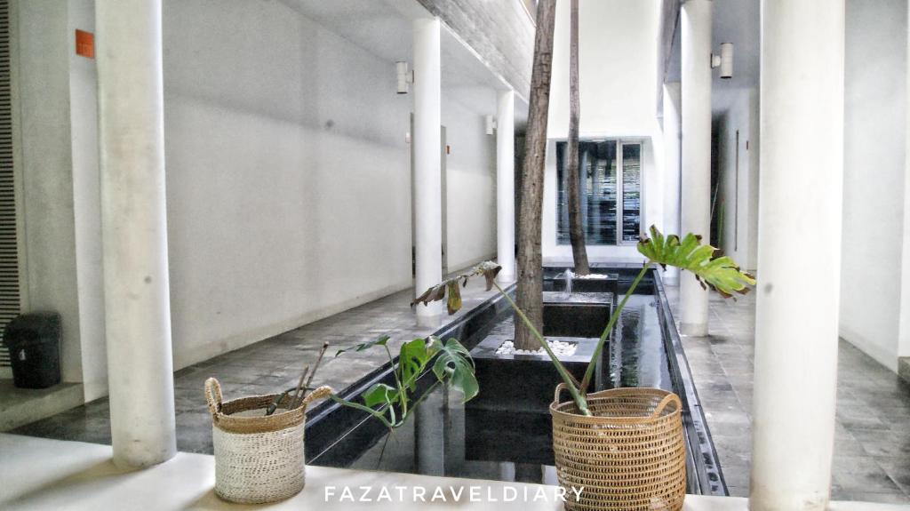 Flat06 minimalist residence jakarta informationen und for Was ist ein minimalist