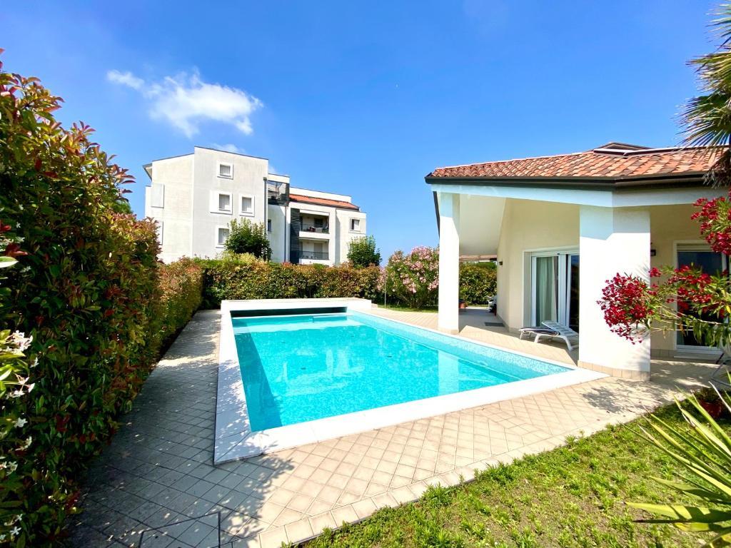 Appartamento in Villa Daniela con piscina privata Carraro ...