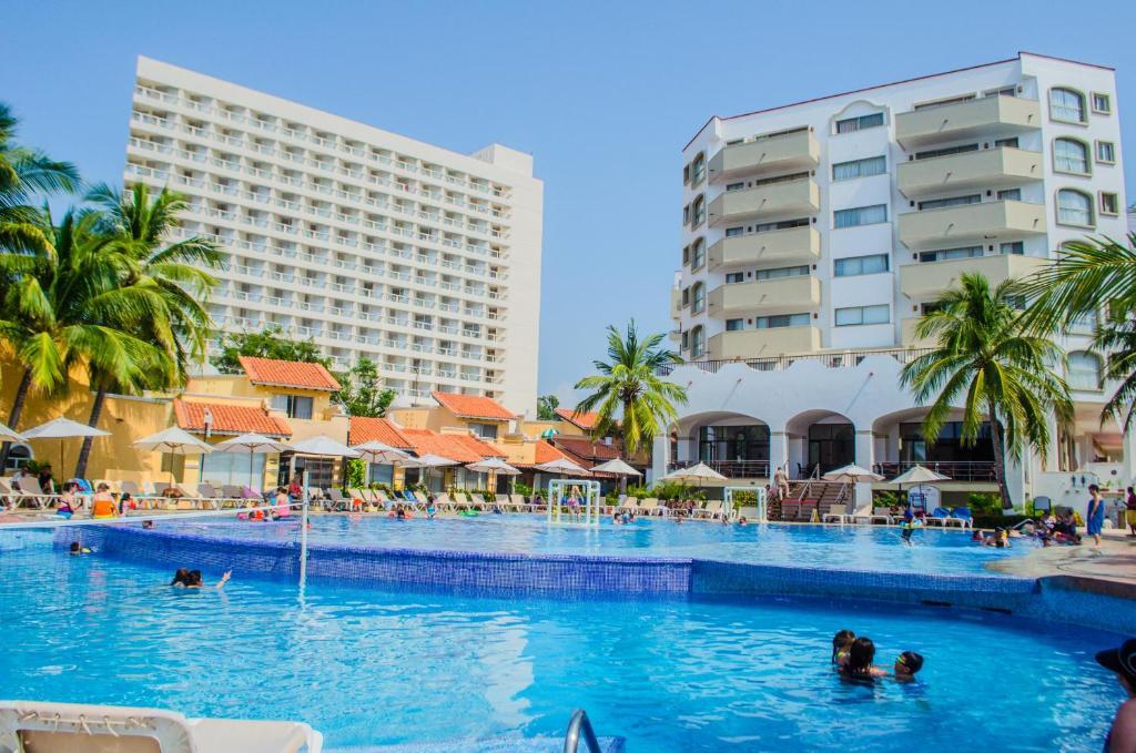 Enna inn ixtapa rooms zihuatanejo reserva tu hotel con for Habitaciones familiares lisboa