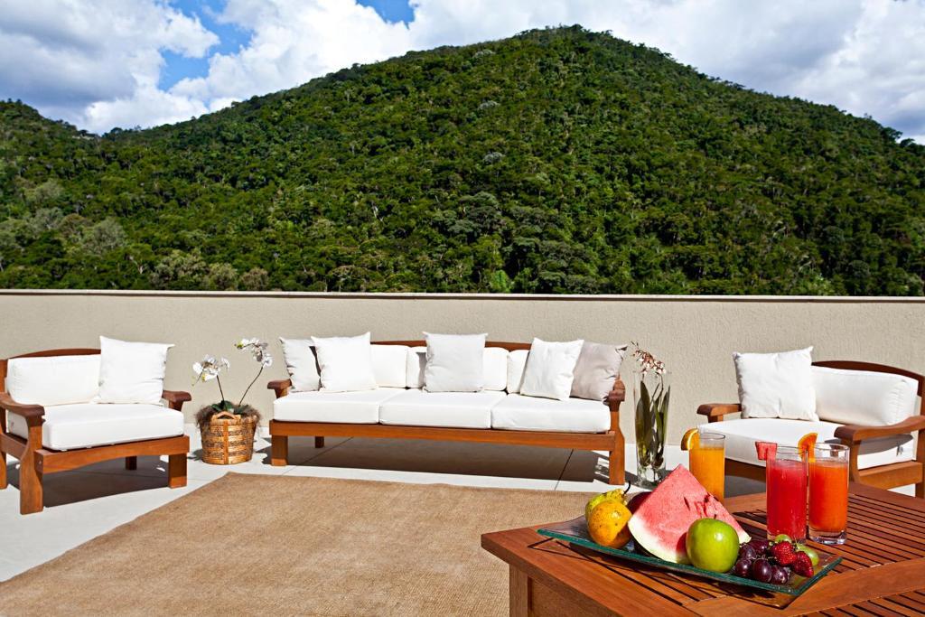 Hotel granja brasil resort petr polis reserva tu hotel for Habitaciones familiares italia