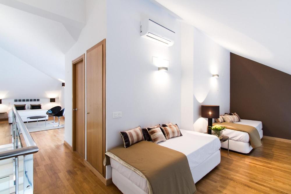 Valencia boutique center valencia reserva tu hotel con for Habitaciones familiares valencia