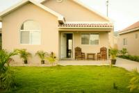 caymanas estate AJ Guest house, Ferienhäuser - Caymanas