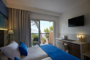 Invisa Hotel Club Cala Blanca, Hotely  Es Figueral Beach - big - 20
