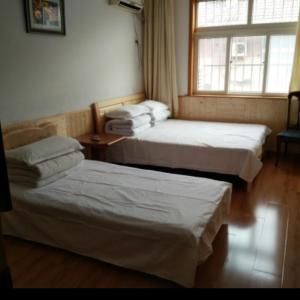 Laoshan Shengyoujia Guesthouse, Vendégházak  Csingtao - big - 3