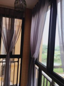 Lai Dou Zhen Seaview Apartment, Apartmanok  Tungsan - big - 12