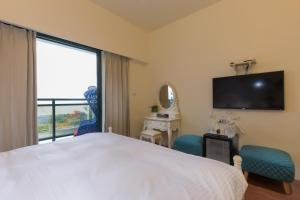 Muxia Siji Sea View Guesthouse, Privatzimmer  Yanliau - big - 32
