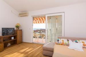 Apartments Garmaz, Ferienwohnungen  Podgora - big - 38