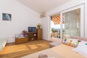 Apartments Garmaz, Ferienwohnungen  Podgora - big - 39