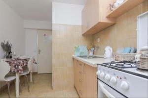 Apartments Garmaz, Ferienwohnungen  Podgora - big - 51