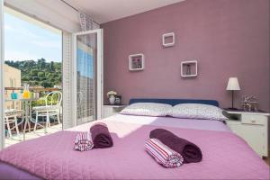 Apartments Garmaz, Ferienwohnungen  Podgora - big - 58