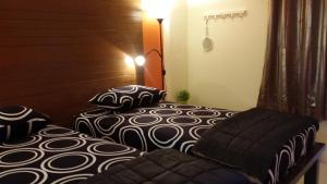 Dvoulůžkový pokoj Deluxe s oddělenými postelemi