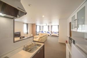 Condominium Panoramique Motomachi, Apartments  Hakodate - big - 23