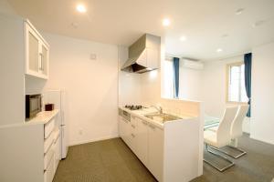 Condominium Panoramique Motomachi, Apartments  Hakodate - big - 35