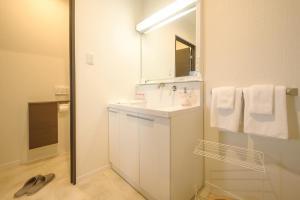Condominium Panoramique Motomachi, Apartments  Hakodate - big - 62