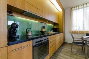 BalatonBee Apartman, Appartamenti  Balatonlelle - big - 24