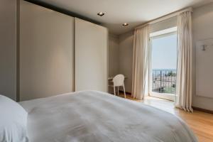 Villa Mughetto, Apartmanhotelek  Gardone Riviera - big - 6