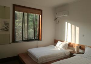Pure-Land Villa, Privatzimmer  Suzhou - big - 12