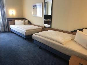 Dvoulůžkový pokoj typu Classic s oddělenými postelemi