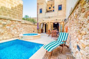 Holiday Farmhouse with Private Pool in Nadur Gozo, Prázdninové domy  Nadur - big - 17