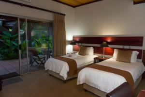 Двухместный номер с 1 кроватью размера «king-size» или 2 отдельными кроватями и выходом в сад (ванная комната с туалетом и ванной) - Номер 11
