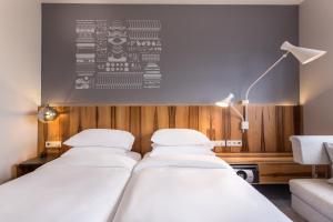 Dvoulůžkový pokoj se 2 oddělenými postelemi a přístupem do klubu