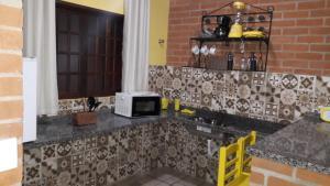Toca Hospedaria - Centro, Apartmanok  São Bento do Sapucaí - big - 10