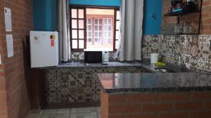 Toca Hospedaria - Centro, Apartmanok  São Bento do Sapucaí - big - 9