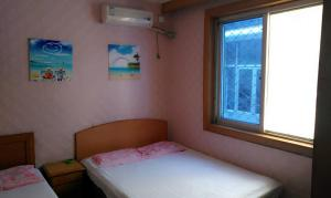 Beidaihe Lijianying Family Inn, Privatzimmer  Qinhuangdao - big - 9
