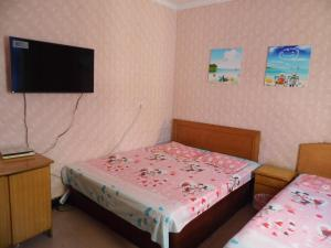 Beidaihe Lijianying Family Inn, Privatzimmer  Qinhuangdao - big - 14