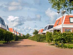 Holiday Home Bungalowparck Tulp & Zee.4, Holiday homes  Noordwijk - big - 11