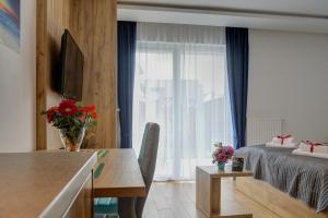 Aparthotel Marina Jastarnia, Apartmanhotelek  Jastarnia - big - 17