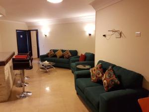 Nile Hunters Suites & Apartments, Szállodák  Kairó - big - 32