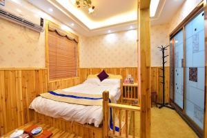Zhaoxiahong Art hotel, Проживание в семье  Wujiaqiao - big - 186