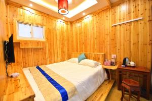 Zhaoxiahong Art hotel, Проживание в семье  Wujiaqiao - big - 185