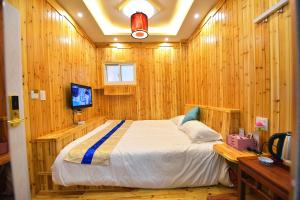 Zhaoxiahong Art hotel, Проживание в семье  Wujiaqiao - big - 177
