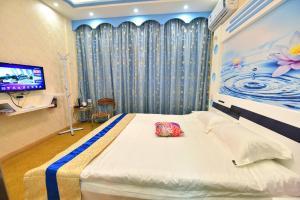 Zhaoxiahong Art hotel, Проживание в семье  Wujiaqiao - big - 176