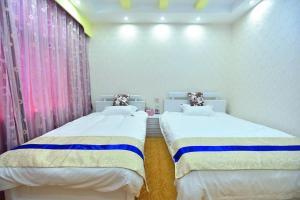 Zhaoxiahong Art hotel, Проживание в семье  Wujiaqiao - big - 164