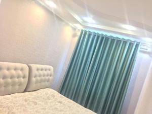 Apartment Navaginskaya 12, Апартаменты  Сочи - big - 16