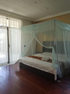 Xinyue Lijing Apartment, Appartamenti  Sanya - big - 7