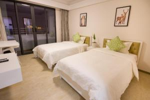 Baorui Railway Boutique Apartment, Ferienwohnungen  Sanya - big - 2