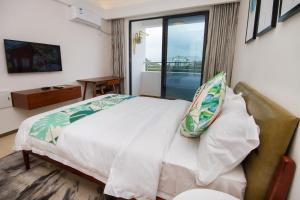 Baorui Railway Boutique Apartment, Ferienwohnungen  Sanya - big - 21