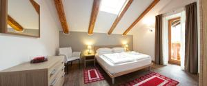 Residence Cavanis Wellness & Spa, Aparthotely  Sappada - big - 10