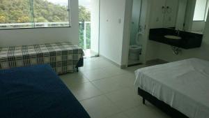 Apartamento Mirante de Escarpas, Apartmány  Capitólio - big - 18