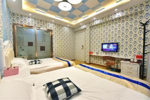 Zhaoxiahong Art hotel, Проживание в семье  Wujiaqiao - big - 273