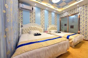 Zhaoxiahong Art hotel, Проживание в семье  Wujiaqiao - big - 271