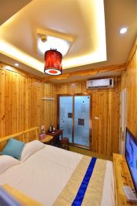 Zhaoxiahong Art hotel, Проживание в семье  Wujiaqiao - big - 266