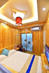 Zhaoxiahong Art hotel, Проживание в семье  Wujiaqiao - big - 265