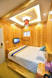 Zhaoxiahong Art hotel, Проживание в семье  Wujiaqiao - big - 264