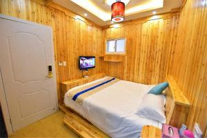 Zhaoxiahong Art hotel, Проживание в семье  Wujiaqiao - big - 263