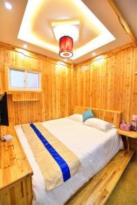 Zhaoxiahong Art hotel, Проживание в семье  Wujiaqiao - big - 261